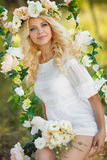 Beautiful woman with a wreath of flowers. Royalty Free Stock Image