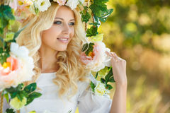 Beautiful woman with a wreath of flowers. Stock Photography
