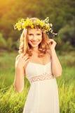 Beautiful woman in wreath of flowers Stock Photo