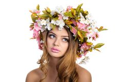 Beautiful woman with a wreath of flowers Royalty Free Stock Photos