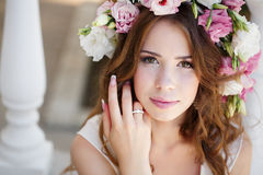 Beautiful woman in wreath of flowers Royalty Free Stock Image