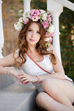 Beautiful woman in wreath of flowers Royalty Free Stock Photos