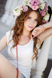 Beautiful woman in wreath of flowers Stock Image