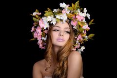 Beautiful woman with a wreath of flowers Stock Photo