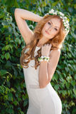 Beautiful woman in a wreath of fresh flowers Royalty Free Stock Photo