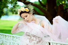 Beautiful woman with a wreath of roses Royalty Free Stock Photography