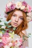Beautiful woman in wreath of roses with flowers bouquet Royalty Free Stock Photo