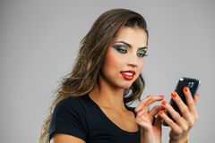 Beautiful woman writes a message on the phone Royalty Free Stock Photography
