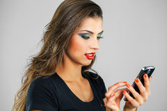 Beautiful woman writes a message on the phone Stock Photo