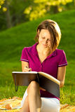 Beautiful woman writing in her diary Stock Photos