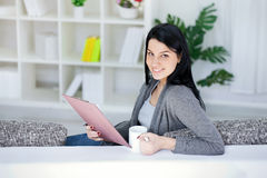 Beautiful woman writing in a notepad royalty free stock photography