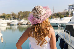 Beautiful woman in yachts beach Stock Image