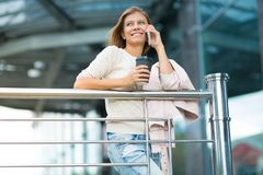 Woman 30 years old walking in the city on a sunny day royalty free stock photography