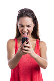 Yelling to a cellphone Stock Photography