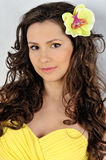 Beautiful woman in a yellow. Royalty Free Stock Photography