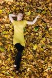 Beautiful woman - yellow autumn leaves - fall Stock Photography