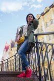 Beautiful woman with yellow bag on the street. People stock photography