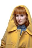 Beautiful woman in a yellow coat. Close up of beautiful woman in a yellow coat Royalty Free Stock Image
