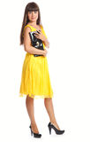 Beautiful woman in yellow dress. Beautiful woman in  yellow dress with bags. Isolated on white background Royalty Free Stock Images