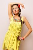 Beautiful woman in a yellow dress. Royalty Free Stock Image