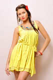 Beautiful woman in a yellow dress. Royalty Free Stock Photography