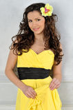 Beautiful woman in a yellow dress. Stock Photo