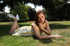 Beautiful woman in yellow dress enjoys summer sun Royalty Free Stock Photo
