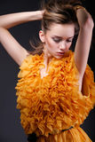Beautiful woman in yellow dress looking down Royalty Free Stock Image