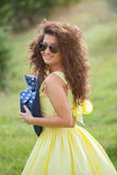Beautiful woman with yellow dress at the park Stock Images