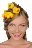 Beautiful woman with yellow ducks in her hair Royalty Free Stock Photography