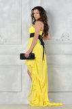 Beautiful woman in yellow evening dress. royalty free stock photography