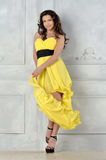Beautiful woman in yellow evening dress. Royalty Free Stock Photos