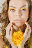 Beautiful woman with yellow flower Stock Images