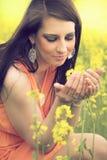 Beautiful woman with yellow flowers Stock Photo