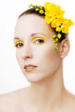 Beautiful woman with yellow flowers in her hair Stock Photos