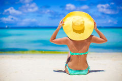 Beautiful woman in yellow hat on white tropical Royalty Free Stock Image