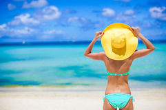 Beautiful woman in yellow hat on white tropical Stock Photography
