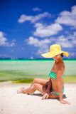 Beautiful woman in yellow hat on white tropical Royalty Free Stock Photography