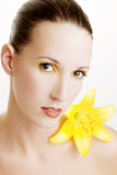 Beautiful woman with a yellow lily Stock Photo