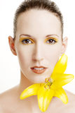 Beautiful woman with a yellow lily Stock Image