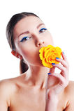 Beautiful woman with yellow rose flower in her mouth Royalty Free Stock Images