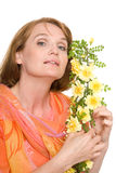 Beautiful woman with yellow roses. Stock Image
