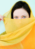 Beautiful woman with a yellow scarf Stock Photos