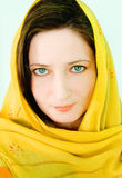 Beautiful woman with a yellow scarf Royalty Free Stock Images