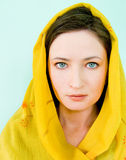 Beautiful woman with a yellow scarf Stock Photography