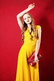 Beautiful Woman in Yellow Silky Dress Royalty Free Stock Images