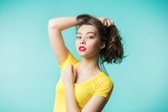Beautiful woman in yellow t-shirt royalty free stock images