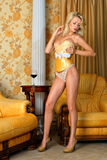 Beautiful woman in yellow underwear in interior. Stock Photos