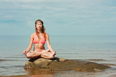 Beautiful woman yoga on the beach Royalty Free Stock Photos