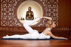 Beautiful woman yoga pilates gymnastics meditation Buddha Stock Photography